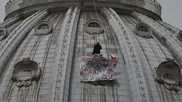Protester unfurls banner on St. Peter's Basilica dome