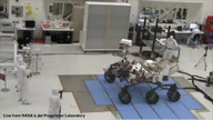 Curiosity rover turns and drives.
