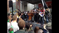 Protesters in NYC join together in song for Mayday