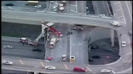 Raw: Truck dangles off Florida highway overpass